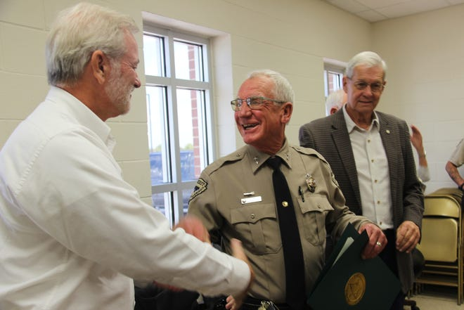 Love County Undersheriff Harvey Stewart is presented with a citation of congratulations after serving the county for 30 years. Stewart will go into retirement at the end of October.