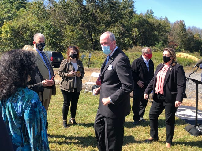 Gov. Phil Murphy speaks with Evesham officials on Friday, Oct. 9, at the Evesham Blue Barn Recreation Center after announcing the formation of the Local Government Emergency Fund.