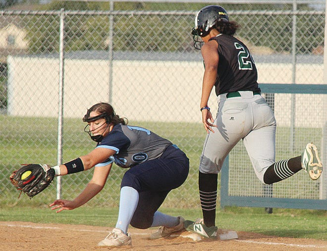 Kaitlyn Sanders, left, snares the ball just in time for an out during Bartlesville High School action earlier in her Lady Bruin career.
