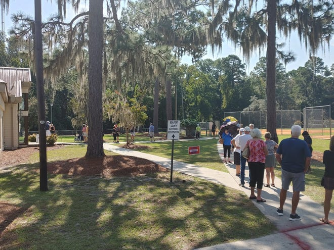 In-person absentee voters in Beaufort County, like those seen here in Bluffton on Thursday, encountered long lines at times this week.