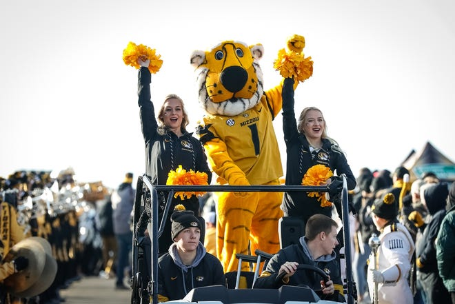 The Missouri Tigers, led by Truman the Tiger, enter Memorial Stadium during the traditional Tiger Walk prior to their game against the Florida Gators in 2019 at Faurot Field.