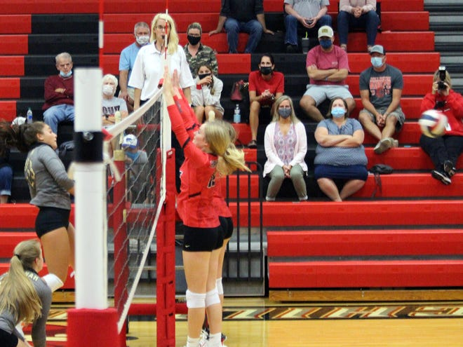 "The double-block ""wall"" put up by Chillicothe (Mo.) HS volleyball Lady Hornets sophomore Anna Fischer (nearest camera at right) and freshman Delanie Kieffer (partially obscured behind Fischer) forces a Savannah player's spike attempt to sail wide of the far sideline, giving CHS a point and the serve during Thursday's Savannah straight-games win in Chillicothe  ( C-T Photo / Paul Sturm )"