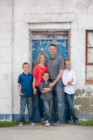 Heather Cramer with her husband, Chad, and their three sons.