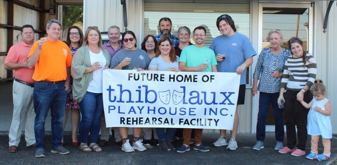 The board of directors of the Thibodaux Playhouse celebrates the opening of the new rehearsal and storage facility in Thibodaux on Sept. 29. From left: Robbie Adams, Daman Stentz, Andrea Stentz, Melinda Adams, Tony Rouse, Hannah Adams, Geralyn Scott Percle, Wesley Annis, Alissa Griffin, Erica Gilfour Annis, Gregory Autin, Mason Clark, Carlotta Toups, Brittany Rogers Bourque and Annabelle Bourque.