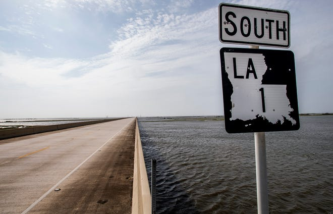 This file photo from Oct. 9, 2020 shows Hwy. 1 near the Louisiana coast.