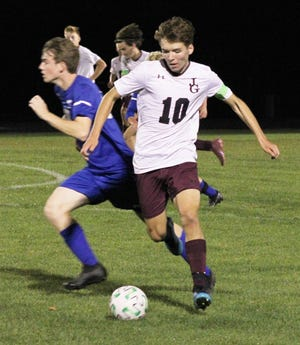 John Glenn's Austin Driggs (10) dribbles the ball during Thursday night's soccer match-up with host Cambridge High. (Michelle Witt, Daily-Jeff.com)