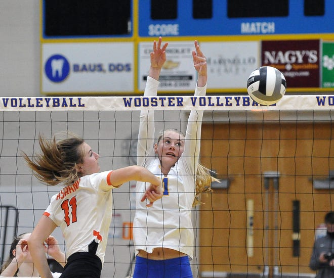 Ashland's Brynn Holt tries to get the ball past Wooster's Emmaleigh Allen during the Arrows' win.