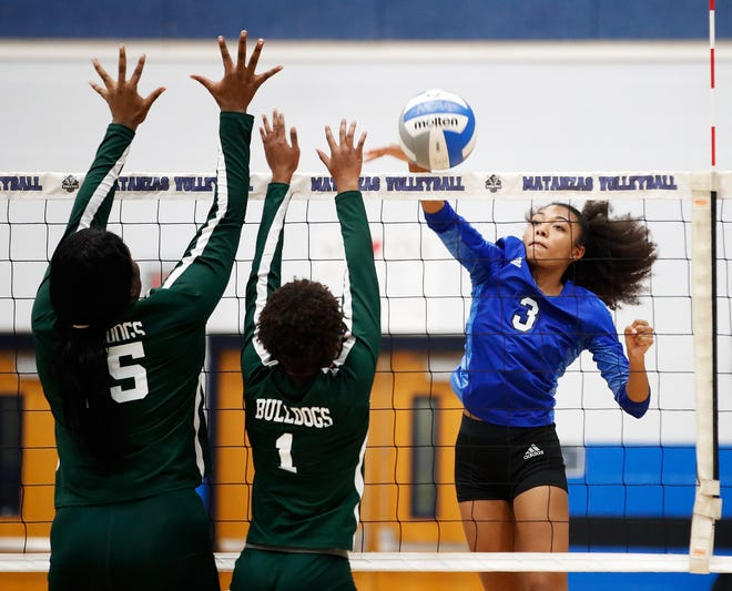 Matanzas' Bri Whitfield attempts a kill in Thursday night's match with Flagler Palm Coast. Matanzas is the only public Volusia-Flagler program to opt out of the state volleyball series.
