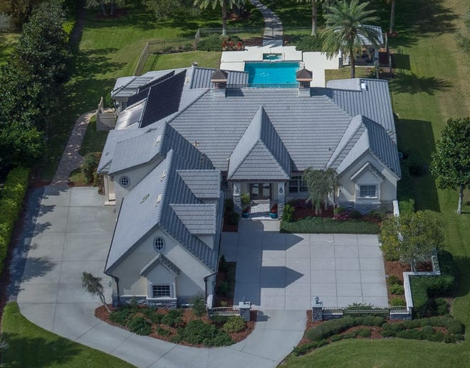 This house on Island Estates Parkway sold recently for $2 million. Built in 1998 in a gated community on the Intracoastal Waterway, it has four bedrooms and six baths in 4,953 square feet of living space. It also has a fireplace, a summer kitchen, a screened lanai, a pool and spa, a dock and boathouse and a covered patio pavilion.