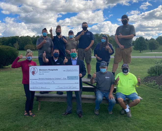 Golf outing benefits Shriners Mound Grove Golf Course recently hosted the annual Ed Biebel Sr. Memorial Golf Tournament to benefit Shriners Hospitals for Children — Erie. The group presented a check for $5,002 to the Shriners. Pictured, from left, front row: Stephanie Biebel, owner, Mound Grove Golf Course; Skyler Drumheller, David R. Schumacher, development officer, Shriners Hospitals for Children — Erie; Fran Szklenski, Vern Skarzynski Back row: James Maille, Marissa Kalie, John Szklenski, Steve Evan, Shelby Cress and Dakota Paris.