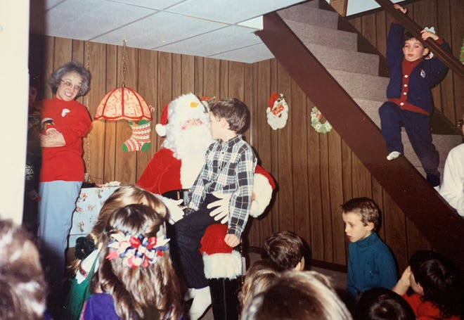 Christopher LaFuria sits on Santa's lap in this undated family photo. The Santa gatherings were a family tradition.