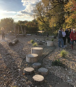 Visitors explore the new  Gerry Aggers McKean PTA Exploration Trail at McKean Elementary School on Thursday.