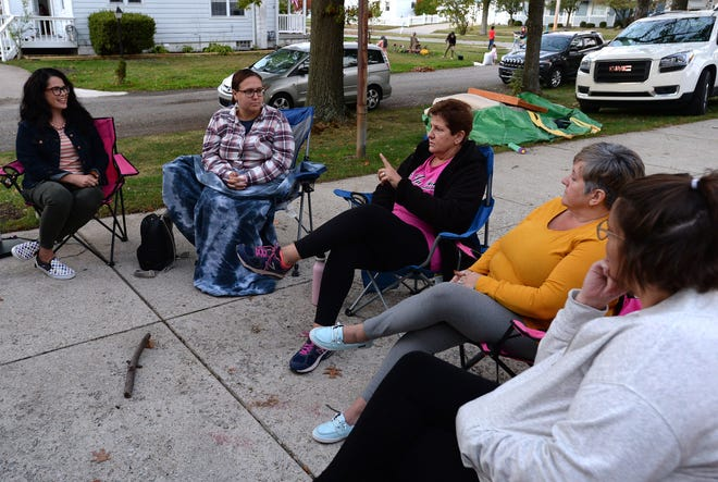 From left, Amanda Burlingham of Erie, Jenna Schreiner of Erie, Diane Kuvshinikov of North East, Dorine Biggie of Millcreek Township and Jen Holsopple of Girard, members of Erie City Moms, hold a meeting in Erie on Oct. 8.
