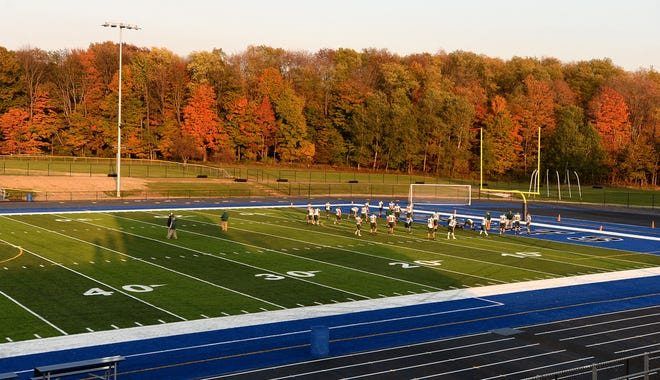 Union City warms up before playing Seneca on Friday in the District 10 football game at Diffenbacher Field at Seneca. This is the first game on the renovated field.