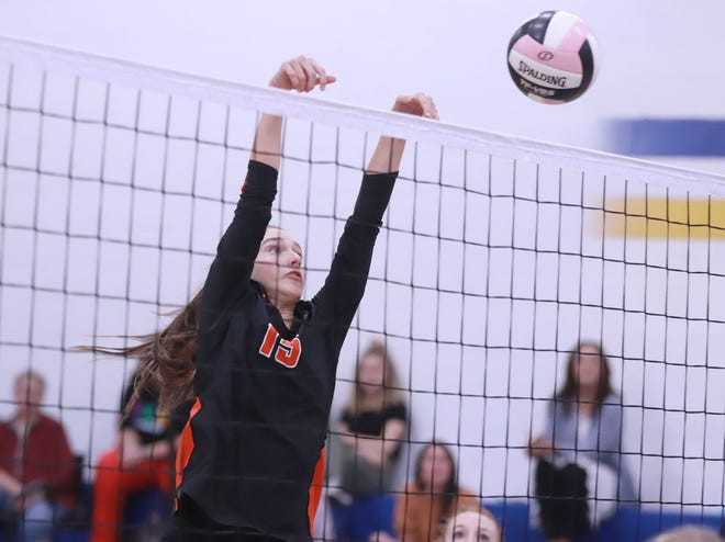 Mediapolis' Hanna Wagenbach pushes the ball over the net in their 3-2 win over Wapello.