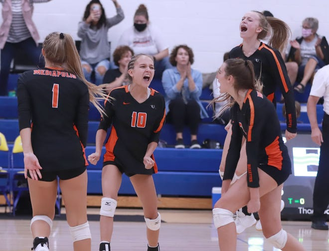 Mediapolis' Lilly Luttenegger (10) celebrates the Bullettes win over Wapello at Wapello. Pictured left to right are Kennedy Welliver (1), Luttenegger, Haley Steffener (back) and Josie Wolter.