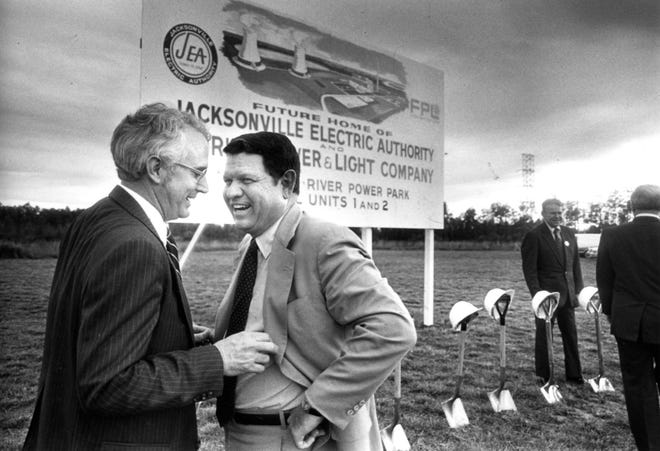 In this Dec. 1, 1982 file photo, Walter Williams Jr., chairman of the board for JEA, speaks with Mayor Jake Godbold before the commencement of the groundbreaking ceremonies for the JEA-FPL St. Johns River Power Park project. Williams died Sept. 30, 2020, in a boating accident.