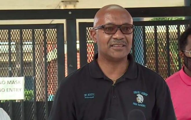 Ribault High School Principal Gregory Bostic addresses a campus shooting Friday.