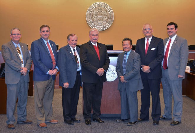 Onslow County Board of Commissioners, left to right, Commissioners Royce Bennett, Tim Foster, Vice Chairman Paul Buchanan, Chairman Jack Bright, Commissioners Robin Knapp, Mark Price and William Shanahan.