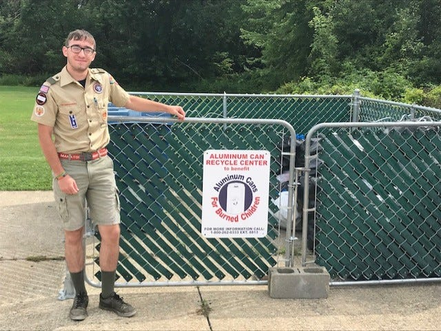 Nicholas Wengerd earned his Eagle Scout rank by building this enclosure at the Tallmadge Fire Station #1 to hold donated aluminum cans.