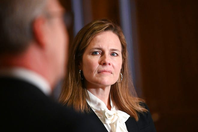 Judge Amy Coney Barrett, President Donald Trumps nominee for the U.S. Supreme Court, meets with Sen. Kevin Cramer, R-N.D., on Capitol Hill in Washington, Thursday, Oct. 1, 2020.