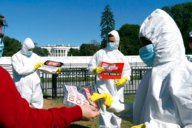 A group protests the ongoing outbreak of coronavirus in the White House, Thursday, Oct. 8, 2020, outside the White House in Washington.