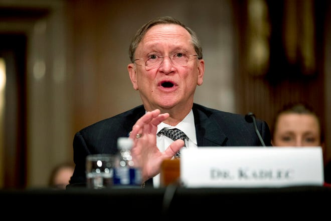 """n this March 3, 2020, file photo, Health and Human Services Assistant Secretary for Preparedness and Response Dr. Robert Kadlec testifies before a Senate Education, Labor and Pensions Committee hearing on the coronavirus on Capitol Hill in Washington. Kadlec said in an email Friday, Oct. 9, that the Trump administration """"is accelerating production of safe and effective vaccines ... to ensure delivery starting January 2021."""""""