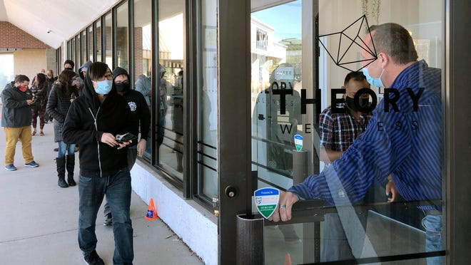 Buyers are let in to purchase cannabis products at Theory Wellness on Friday in South Portland, Maine. Friday was the first day of legal marijuana sales for adult recreational use in the state.