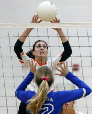 Lakeland setter/right-side hitter Grace Garcia sets the ball against Lakeland Christian. Garcia, a junior, has helped the Dreadnaughts have a bounce-back season this year.