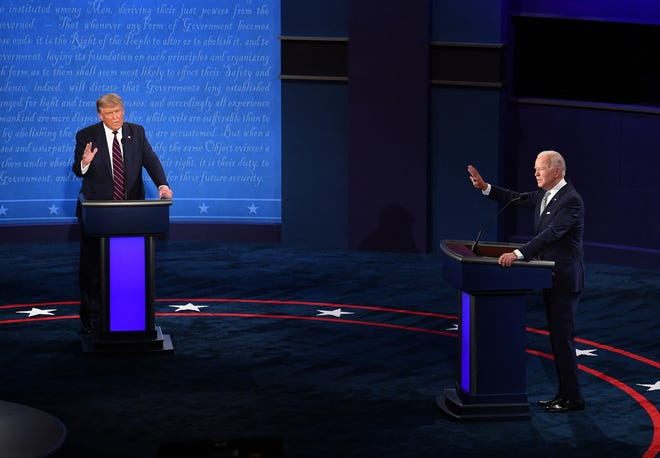 President Donald Trump, left, and Democratic presidential nominee Joe Biden during the first of three scheduled 90-minute presidential debates in Cleveland on Sept. 29. Next week's debate between Biden and Trump has officially been canceled after Trump refused to accept the organizer's decision to keep the event virtual out of COVID-19 concerns, according to a person familiar with the matter.