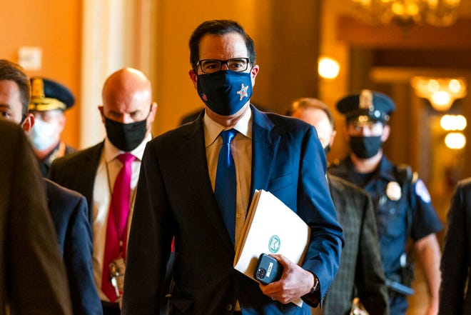 Treasury Secretary Steven Mnuchin, walks from the office of Senate Majority Leader Sen. Mitch McConnell of Ky., as he leaves the Capitol, Wednesday, Sept. 30, 2020, in Washington. Mnuchin earlier met with House Speaker Nancy Pelosi of Calif.