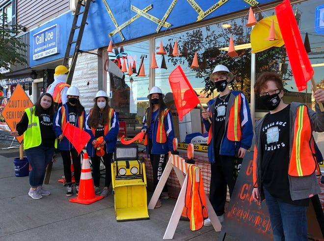 Some of the members of the Bloomfield High School senior class demonstrate their school spirit Friday at Call Joe Appliance Store in the village. The COVID-19 pandemic threw a wrench in the school's traditional homecoming plans, but this is one way students adjusted.