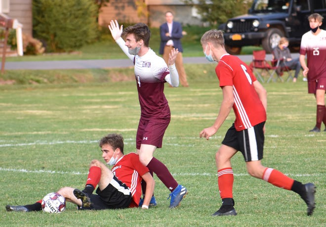 Clinton and Sauquoit Valley battle in a boys soccer game Friday night at Clinton Central School. [MARQUEL SLAUGHTER / OBSERVER-DISPATCH]