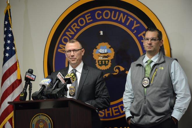 Pocono Mountain Regional Police Chief Chris Wagner, at podium, with Det./Sgt. Lucas Bray, at a press briefing on the shootings that killed a brother and sister and injured another man.