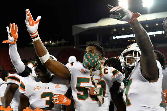 Miami Hurricanes linebacker Zach McCloud (53) celebrates with teammates during a victory at Louisville this season. [ACC Pool]