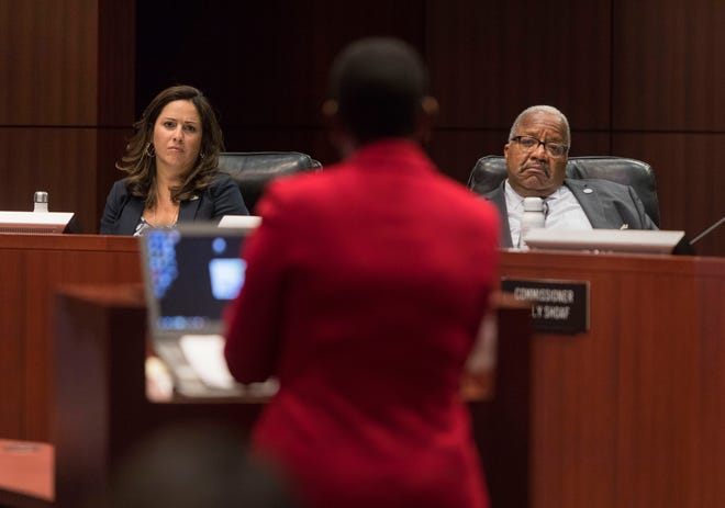 City Commissioner Christina Lambert, left, and Mayor Keith James listen to City Administrator Faye Johnson during a 2019 meeting. [GREG LOVETT /palmbeachpost.com]