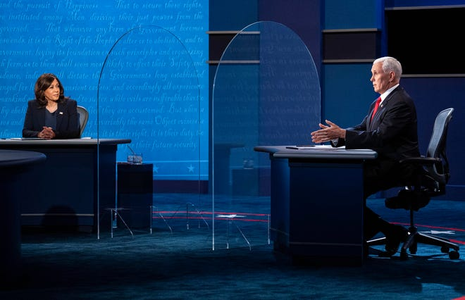 Sen. Kamala Harris (D-Calif.) and Vice President Mike Pence participate in the vice presidential debate at the University of Utah in Salt Lake City, Wednesday, Oct. 7, 2020. The pandemic took up only a few questions at the vice presidential debate — but it was everywhere. [Ruth Fremson/The New York Times]