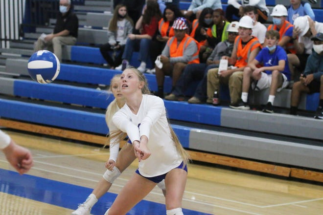 Perry senior Quinn Whiton answers a Dallas Center-Grimes serve on Thursday, Oct. 8 in the Jayette Invitational.