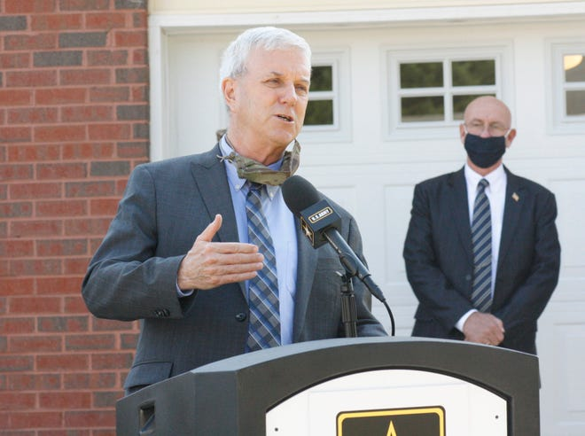Undersecretary of the Army James E. McPherson discusses military housing outside of a newly-renovated Jackson Circle house on Fort Lee on Oct. 7, 2020.