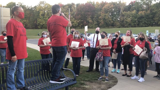 Streetsboro Education Association President John Oleksa and Streetsboro Support Staff Personnel Association President Paula Cooley address members outside of the Board of Education meeting on Thursday.