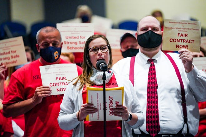 Streetsboro High School teacher Molly Klodor, flanked by colleagues Robb Kidd and Kris Gaug, makes the case for a better contract at Thursday's Streetsboro Board of Education meeting.