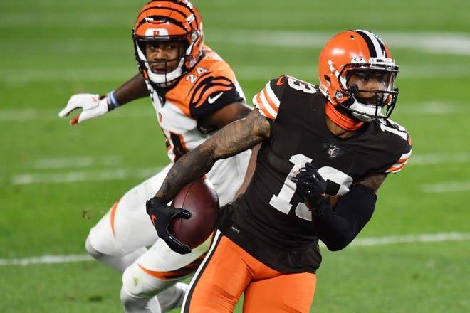Sep 17, 2020; Cleveland, Ohio, USA; Cleveland Browns wide receiver Odell Beckham Jr. (13) runs with the ball after a catch as Cincinnati Bengals strong safety Vonn Bell (24) defends during the first half at FirstEnergy Stadium. Mandatory Credit: Ken Blaze-USA TODAY Sports