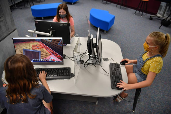 In this archive photo from Aug. 28, Ashton Elementary students work on a project in the school library. From left to right: Shasha Poteralski,8; Mila Poteralski,10, and Taylor McCormack, 8.
