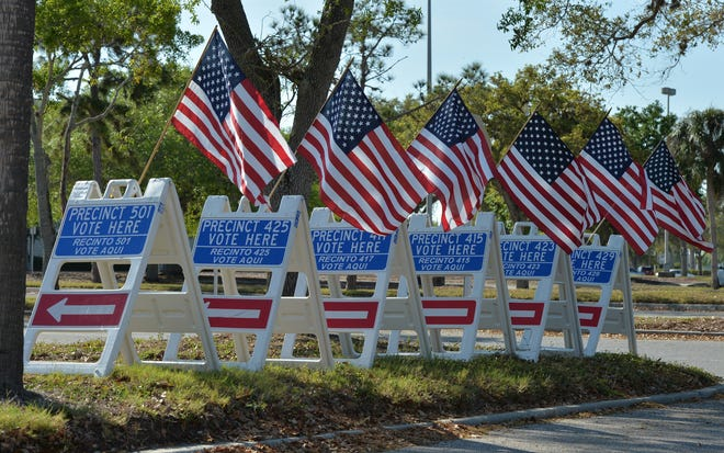 Signs for the combined polling precinct at Westfield Sarasota Square on March 17 in Sarasota.