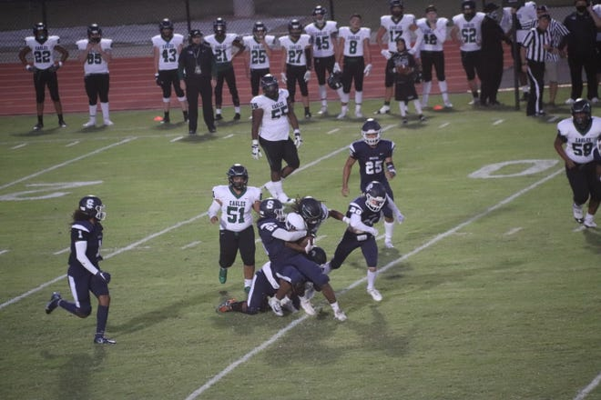 Shawnee's Terrance Shaw (55) wraps up the Tulsa Edison ballcarrier as Wolfpack teammates Joe Maytubby (1), Justice Simpson (25) and Boston Tully (29) pursue on the play last Friday night at Jim Thorpe Stadium.