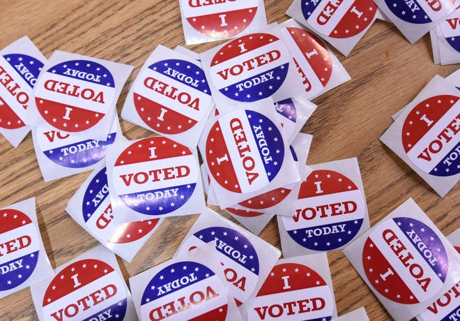 I voted stickers rest on a table at Belville Elementary School in Brunswick County Tuesday Nov. 8, 2016.
