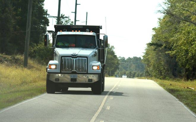 Dump trucks travel along Shaw HWY near Shaw Mine LLC in Rocky Point, N.C.  Wednesday Oct. 7, 2020.