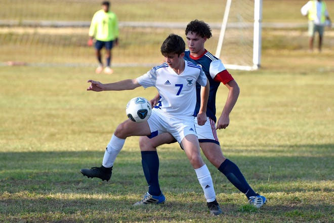 Fayetteville Christian's Andrew Harris defends the ball against Freedom Christian's Coleman Burns during Thursday's game, which decided the NCISAA Sandhills Conference regular-season championship.