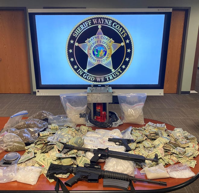 Harnett County Sheriff deputies seized an array of drugs and firearms as well as $415,180 from a man charged with trafficking. [Contributed photo Harnett County Sheriff's Office]