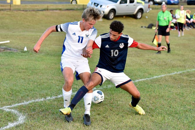 Freedom Christian's Connor Jacobs (10) and Fayetteville Christian's Coyle Garcia battle for the ball during a game on Oct. 8, 2020.